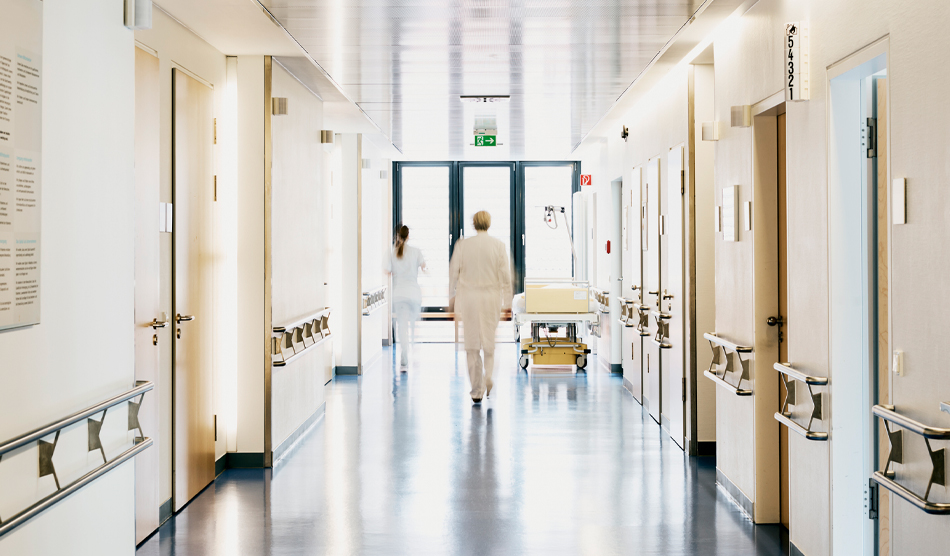 Hospital hallway with few people