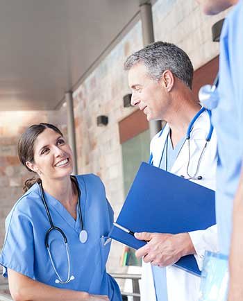 physician and nurse discussing the job fit